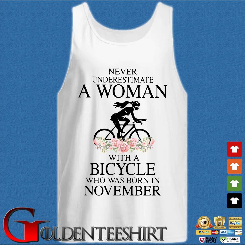 Never Underestimate A Woman With A Bicycle Who Was Born In November Shirt Tank top trắng